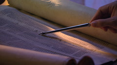 Close-up of opened Torah, stylus following lines from right to left - stock footage