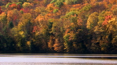 Lake and opposite hillside in fall foliage Stock Footage