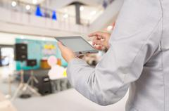 Business Man use Tablet as Director of Event on Stage. Stock Photos