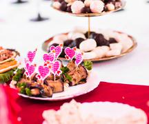 colorful skewers with hearts for snacks - stock photo