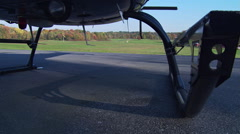Fuselage-mount POV, helicopter taking off from airstrip - stock footage