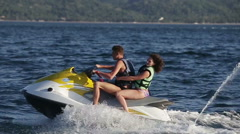 Happy couple riding jet ski - stock footage