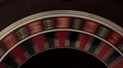 Classic roulette spinning fast black background Stock Footage