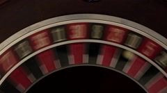 Classic roulette spinning fast black background white number 10 Stock Footage