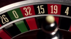 Roulette spins quickly, ball, white, close up Stock Footage