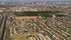 Wide approach toward distant downtown Phoenix from outlying areas. Shot in 2008. - stock footage
