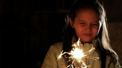 Young girl with sparkler scared to happy - stock footage