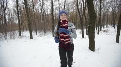 Sportswoman Runs in winter park Stock Footage