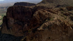 Flight over rugged bluffs to glimpse Arizona's Roosevelt Dam and Salt River. Stock Footage