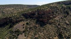 Flight over rugged brush-covered desert hills Stock Footage