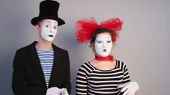 Female mime holding invisible a mask Stock Footage