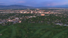 Fast flight over Albuquerque starting from above a golf course. Shot in 2008. Stock Footage