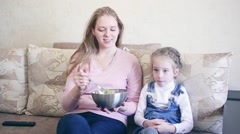 woman with her daughter eat salad - stock footage