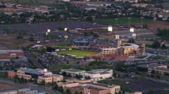 Mid-level flight past baseball stadium, home of Albuquerque Isotopes. Shot in Stock Footage
