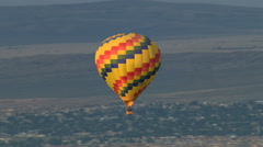 Flight tracking hot air balloon over Albuquerque for close view. Shot in 2008. Stock Footage
