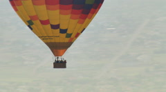 Close mid-air view of hot air balloon and passengers in basket. Shot in 2008. - stock footage