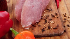 raw turkey meat steak with hot sweet pepper - stock footage