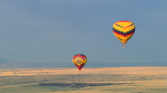 Mid-air view of two hot air balloons gliding over Albuquerque. Shot in 2008. - stock footage