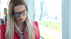 Cute blonde woman reading book while riding tram - stock footage