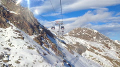 Ski lift view of skiers - stock footage