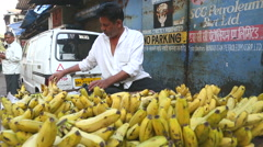 Man selling bananas on ambulant stand on the streets of Mumbai, India. Stock Footage