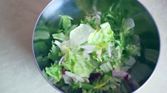 Olive oil pouring over fresh salad Stock Footage