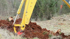Heavy machinery digger excavating earth for construction Stock Footage