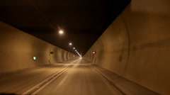 Timelapse of travelling quickly through a car tunnel Stock Footage