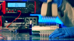 Sample preparation for DNA electrophoresis. Adding samples in Gel Electrophor Stock Footage