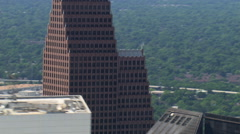 Slightly descending flight close past layered downtown Houston skyscraper tops. Stock Footage