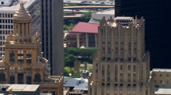 Close orbit over downtown Houston, Esperson Building in center frame. Shot in Stock Footage