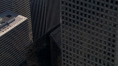 Close partial orbit near layered skyscrapers in downtown Houston. Shot in 2008. - stock footage
