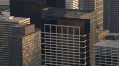Close flight past layered Houston skyscrapers to Gulf Building. Shot in 2008. Stock Footage