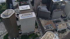 Slow flight over downtown Houston skyscrapers; links to HUA121. Shot in 2007. - stock footage