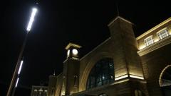 Kings Cross Station, London at night tilt Stock Footage
