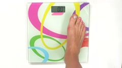 Detail girl weighing herself, on white, top view - stock footage
