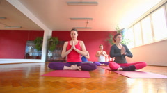 Women doing yoga class in hall Stock Footage