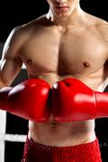 Skillful boxing champion is preparing for fighting - stock photo