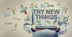 Try New Things concept with man holding a tablet - stock illustration