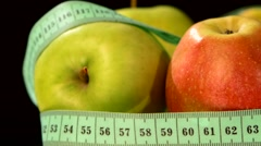 Apple collection with measuring tape, rotation, reflection, on black, close up Stock Footage