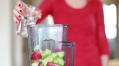View of hand pouring water into blender - stock footage