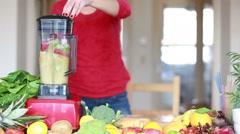 Blending fruits in blender - stock footage