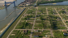 Wide aerial view of remains of residential neighborhood after Hurricane Katrina, - stock footage
