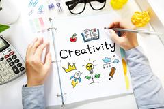 Person drawing Creativity concept on white paper Stock Photos