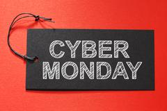 Cyber Monday text on a black tag Stock Photos
