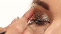 Female eye with long eyelashes. close up Stock Footage