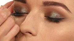 Stock Video Footage of Perfect makeup. Beauty fashion. Eyelashes. Cosmetic Eyeshadow. close up