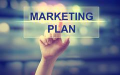 Hand pressing Marketing Plan Stock Photos