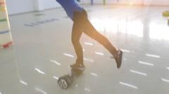 Beautiful sport Girl ride balancing in one Leg Segway motorized scooter io hawk - stock footage