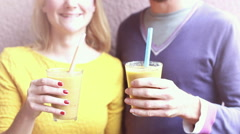 Man and woman drinking healthy smoothie - stock footage